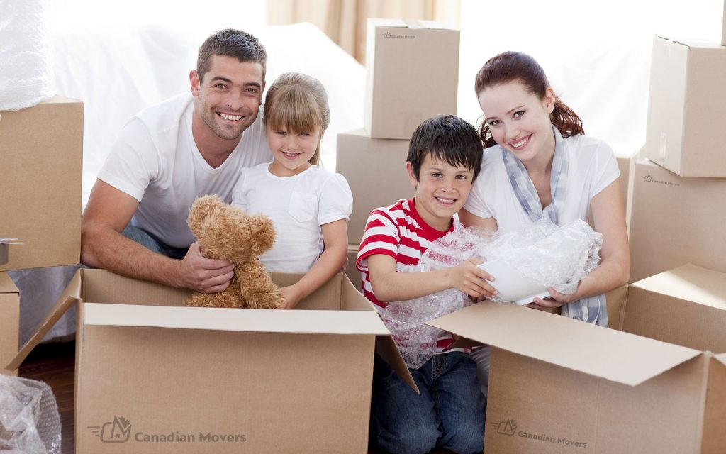 Family moving with boxes and kids