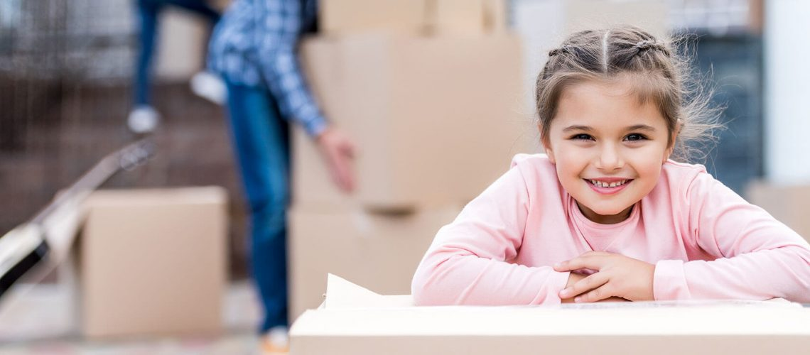 Girl smiling during home move